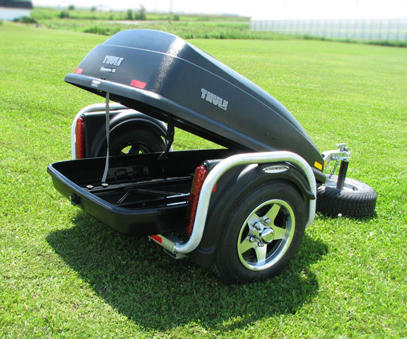 The Pod-ium Lugg, the only trailer so light weight it can be shipped by post! it also uses already available accessories for car's roof such as thule's and sport's rack, no modification needed!